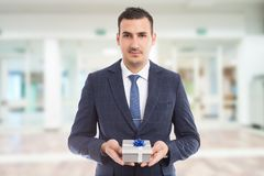 Young handsome lover holding present royalty free stock photo