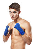 Young handsome male boxer fighter. Isolated on white background stock photos