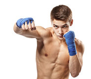 Young handsome male boxer making punches. During training isolated on white background stock image