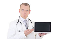 Young handsome male doctor showing laptop with copy space isolat. Ed on white background Royalty Free Stock Photo