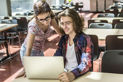 Young handsome male female student at the college Royalty Free Stock Image