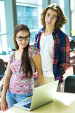 Young handsome male female student at the college Stock Images