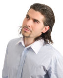 Young handsome male looking up isolated white. Young dark haired caucasian man in light blue striped shirt looking up isolated on white Stock Photo