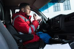 young handsome male paramedic talking royalty free stock images