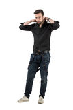 Young handsome male putting on clothes Royalty Free Stock Photography