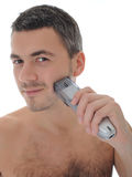 Young handsome male shaving face beard . isolated Royalty Free Stock Photography