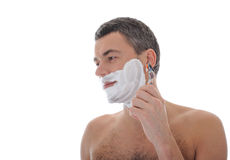 Young handsome male  shaving face beard . isolated. On white background Royalty Free Stock Photos