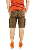 Young handsome male in shorts with hands in pockets from the back Stock Images