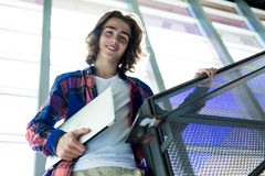Young handsome male student at the college Royalty Free Stock Photos