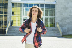 Young handsome male student at the college Stock Photos