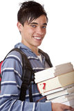 Young, handsome, male student holding books. Young student holding books and smiles happy into camera. Isolated on white Royalty Free Stock Photos