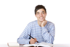 Young handsome male student sitting on desk Royalty Free Stock Image