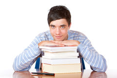 Young handsome male student with study books Stock Image