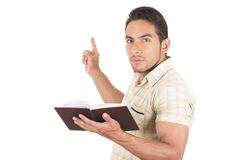 Young handsome male teacher holding notebook Stock Photos