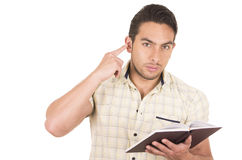 Young handsome male teacher holding notebook. Gesturing listen with finger on ear isolated on white Stock Photos