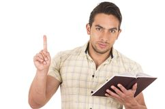 Young handsome male teacher holding notebook Stock Images