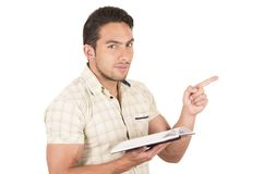 Young handsome male teacher holding notebook Stock Image