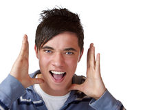Young handsome male teenager screaming Royalty Free Stock Images
