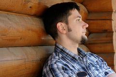 Young handsome man. At the wooden house Royalty Free Stock Images
