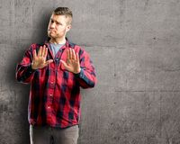 Young handsome man isolated over wall background stock photo