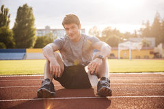 Young handsome man athlete resting with water bottle Royalty Free Stock Image