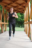 Young handsome man athlete running Stock Image