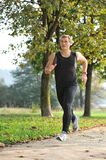 Young handsome man athlete running Stock Images