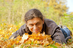 Young handsome man in autumn forest Royalty Free Stock Photo