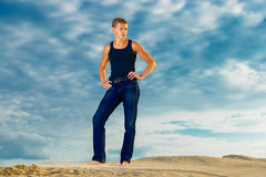 Young handsome man on the beach. Looks thoughtfully into the dis Royalty Free Stock Image