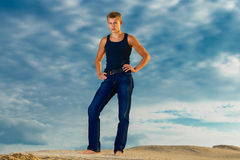 Young handsome man on the beach. Looks thoughtfully into the dis Royalty Free Stock Images