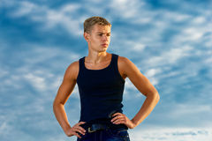 Young handsome man on the beach. Looks thoughtfully into the dis Stock Images