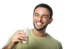 Young Handsome Man with Beard drinking Milk. Happy Young Handsome Man with Beard drinking Milk and Yogurt  on White Background Stock Image