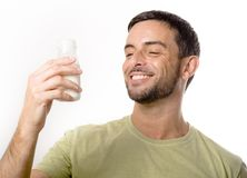 Young Handsome Man with Beard drinking Milk Stock Photography