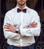 Young handsome man with a beard in luxurious white shirt and blue jacket with bowtie Royalty Free Stock Images