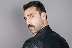 Young handsome man with beard and mustache studio portrait Royalty Free Stock Image