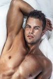 Young handsome man in bedroom Stock Image