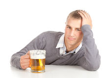 Young handsome man with beer Royalty Free Stock Image