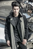 Young Handsome Man in Black Coat Standing in City Stock Image