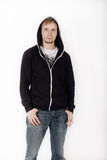 Young handsome man in black hoodies and jeans Stock Images