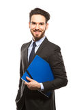 Young handsome man in black suit and folder smiling isolated Stock Photography