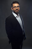 Young handsome man in black suit and glasses Stock Photo