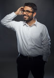 Young handsome man in black suit and glasses Royalty Free Stock Photos