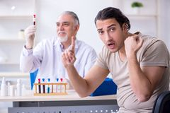 Young handsome man during blood test sampling procedure. The young handsome men during blood test sampling procedure stock images