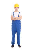 Young handsome man in blue builder uniform isolated on white Royalty Free Stock Photography