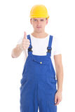 Young handsome man in blue builder uniform thumbs up isolated on Stock Photo