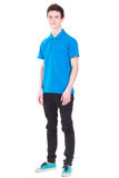 Young handsome man in blue t-shirt isolated on whi. Young handsome man wearing blue t-shirt isolated on white background Royalty Free Stock Photography