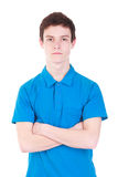 Young handsome man in blue t-shirt isolated on white. Young handsome man wearing blue t-shirt isolated on white background Royalty Free Stock Images