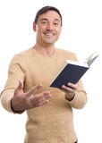 Young handsome man with a book Royalty Free Stock Images