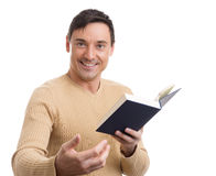 Young handsome man with a book Royalty Free Stock Image
