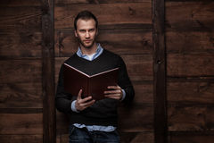 Young handsome man with a book Royalty Free Stock Photography
